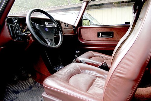 Leather steering wheel and Ox blood red leather seats. Even the dash is red!
