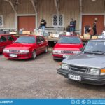 Saab 90 in front and three red Saab 9000.