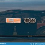 Saab 99 LE badge.