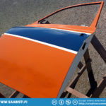 Driver side door with the full color treatment - blue, white, and orange.
