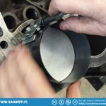 Pushing the piston in with an installation tool.